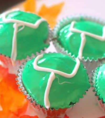 Easy game day cupcakes decorated with green icing and white goalposts
