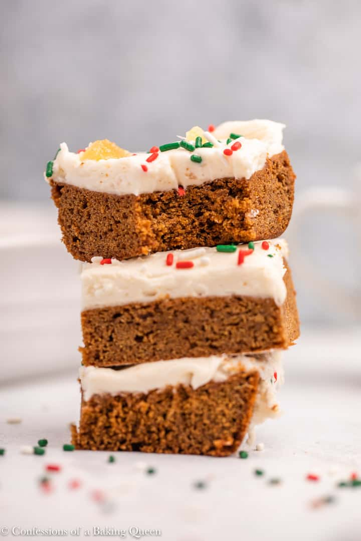 Three frosted gingerbread brownies stacked