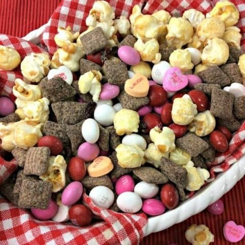 Are you looking for something fun to make for Valentine's Day? This Valentine's Day Cherry Muddy Buddies Snack Mix is awesome for the classroom or for you and your sweetie to snack on.
