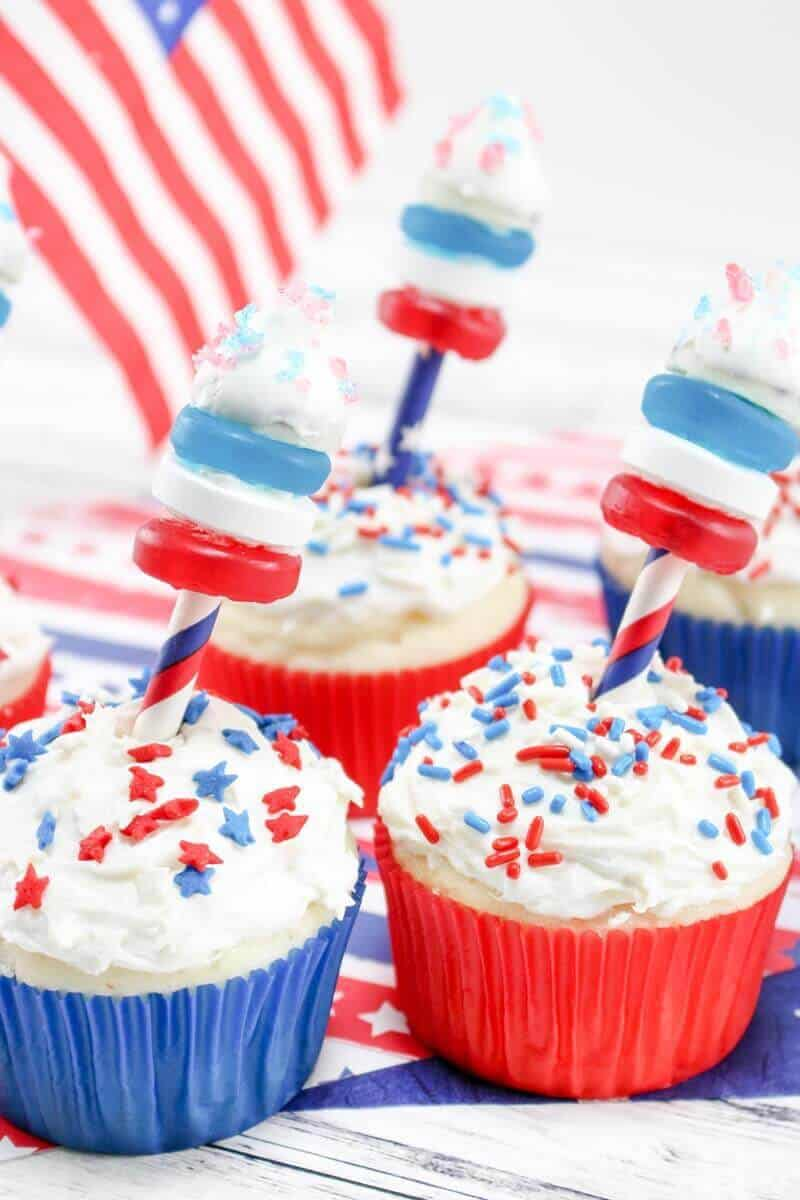 These 4th of July Firework Cupcakes featuring fireworks shooting out of the top make the perfect dessert to serve at your 4th of July party. With Pop Rocks, Hershey Kisses, Lifesavers, and sprinkles, this 4th of July dessert recipe is sure to be a crowd pleaser!
