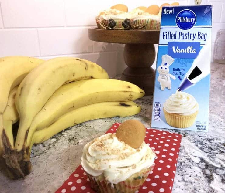 Banana pudding cupcakes: moist, vanilla cupcakes filled with banana pudding and topped with creamy, vanilla frosting and vanilla wafer crumbles.