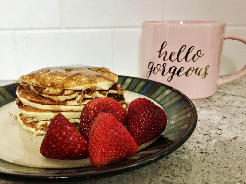 Delicious Krusteaz Chocolate Chip Pancakes, strawberries, and coffee