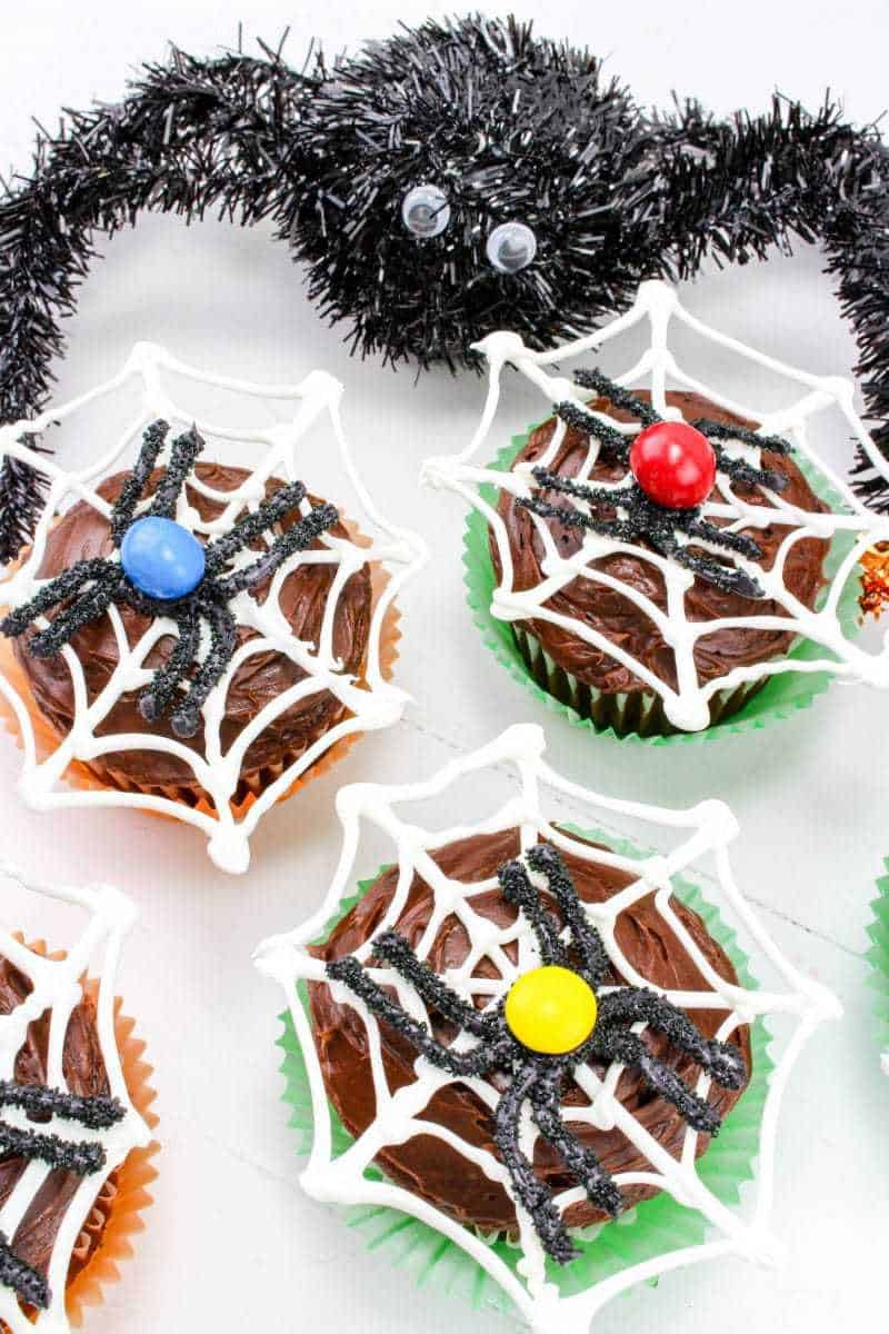 Make Halloween spiderweb cupcakes with chocolate spiders for Halloween! Just follow this easy recipe tutorial.