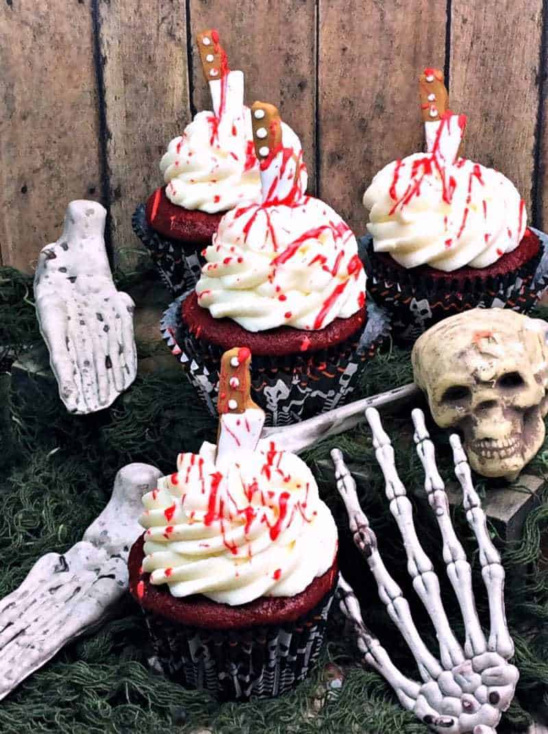 These creepy bloody cupcakes are stabbed with a knife and dripping with blood. A perfect dessert for your Halloween, Zombie, or Walking Dead party.