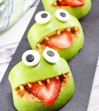 Made with apples, peanut butter, strawberries, sunflower seeds, and edible eyes, these Monster Apple Bites are a fun snack packed with nutrition! Perfect for Halloween or whenever you are looking for a fun snack idea for the kids.
