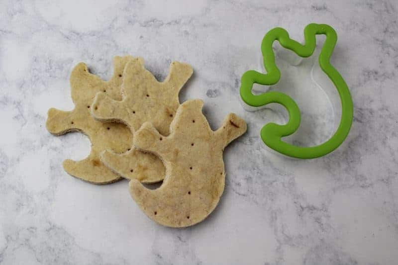 Use a cookie cutter to cut ghost shapes from cooked pizza crusts.