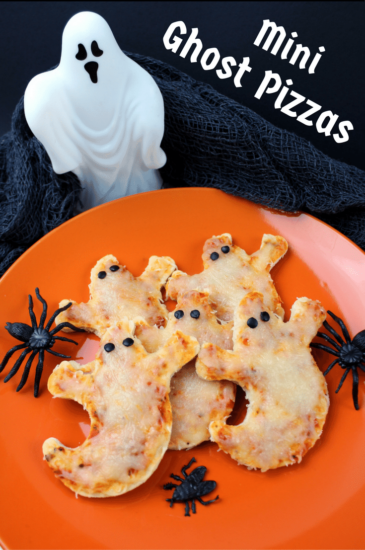 Mini Ghost Pizzas are quick and easy to prepare and make the perfect dinner or snack for all the ghosts and ghouls at your Halloween Party.