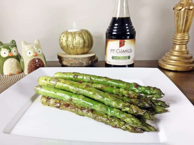 First, heat olive oil and garlic in skillet at medium-high until garlic begins to brown, stirring occasionally. Next, add asparagus, soy sauce, and water to skillet. Roll asparagus to coat and cook evenly. When asparagus is tender, but firm, remove from heat and serve immediately.