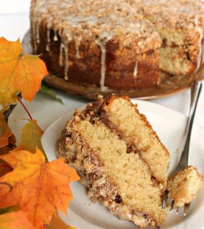 This Maple Walnut Coffee Cake has a thin layer of cream cheese filling, enhanced with toasted walnuts and maple. A generous amount of crumbly streusel on top is drizzled with maple icing, adding layers of flavor that enchant but don't overpower.