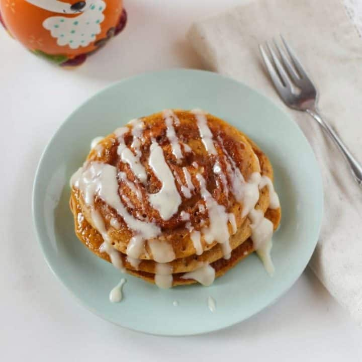 With a cinnamon swirl and a cream cheese glaze, these pumpkin spice pancakes will become a family favorite throughout the fall months and especiallyon Thanksgiving morning.