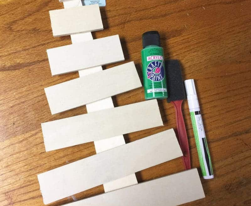 This DIY holiday phrase wooden Christmas tree is the perfect easy DIY Christmas decoration idea. It will make a great addition to your holiday decor.