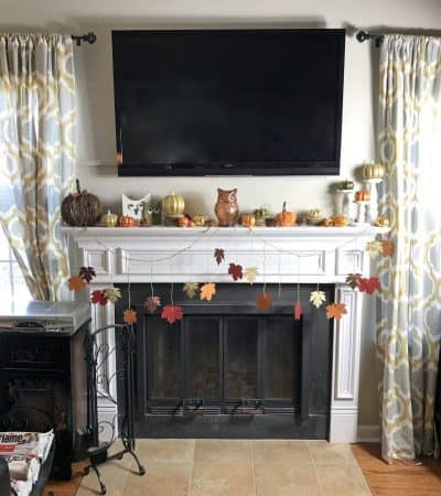 Looking for an easy Fall mantle decor idea? This pumpkin, gourd, owl, leaf, and pinecone mantle is perfect for Halloween, Thanksgiving, and all season long.