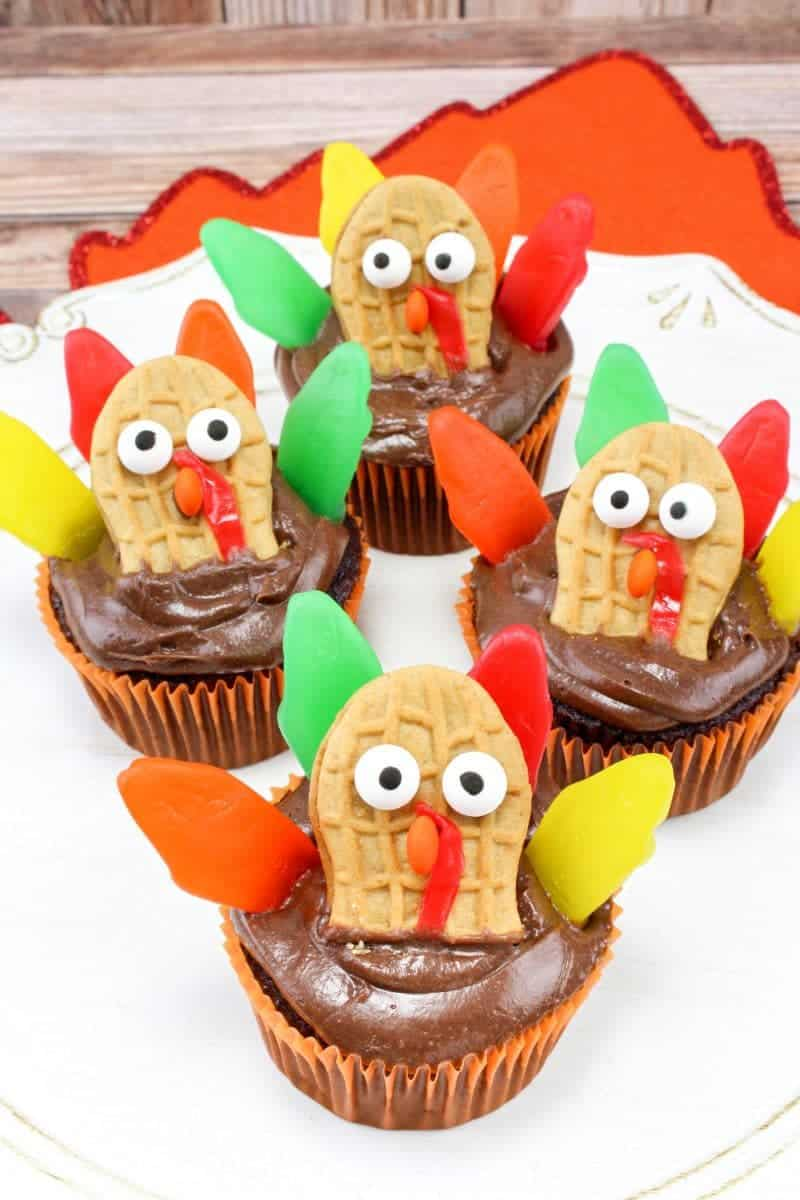 Made with Nutter Butters, Fruit Roll-Ups, Swedish Fish, and mini M&Ms, turkey cupcakes are colorful, tasty, and so much fun for the kids to help create.