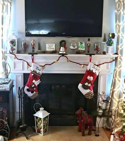 Looking for an easy Christmas mantle decor idea? This cheery mantle decorated with glass jars, lanterns, and pinecones is perfect for Christmas and winter in general.