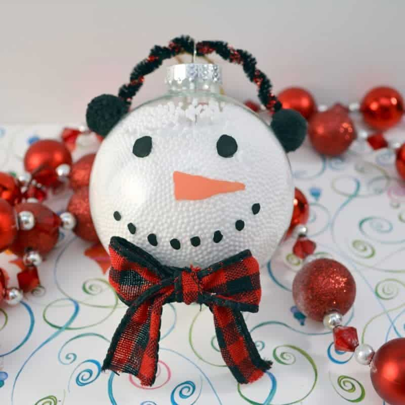 this handmade snowman christmas ornament is fun and easy for the kids to make using clear
