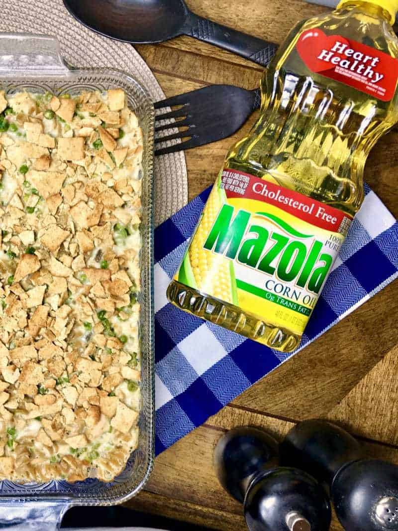 This better for your version of a classic tuna pasta casserole swaps out some of the traditional ingredients for healthier alternatives such as multigrain pasta, low fat cream of mushroom soup, skim milk, reduced fat cheddar cheese, whole grain cracker crumbles, and Mazola Corn oil.