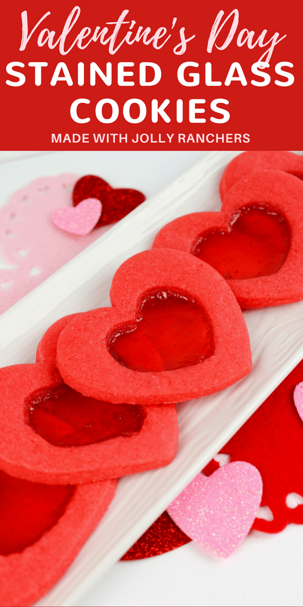 Make a batch of beautiful heart-shaped stained glass cookies this Valentine's Day with this easy recipe, complete with step-by-step images. #ValentinesDayIdeas #ValentinesDayRecipes