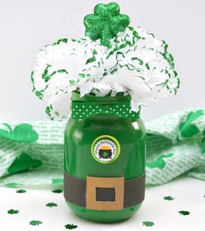 Are you looking for a DIY St. Patrick's Day Decoration idea? This Leprechaun Mason Jar craft is quick and easy to make, and would be perfect as a St. Patrick's Day centerpiece of as a DIY decoration for your St. Patrick's Day party.