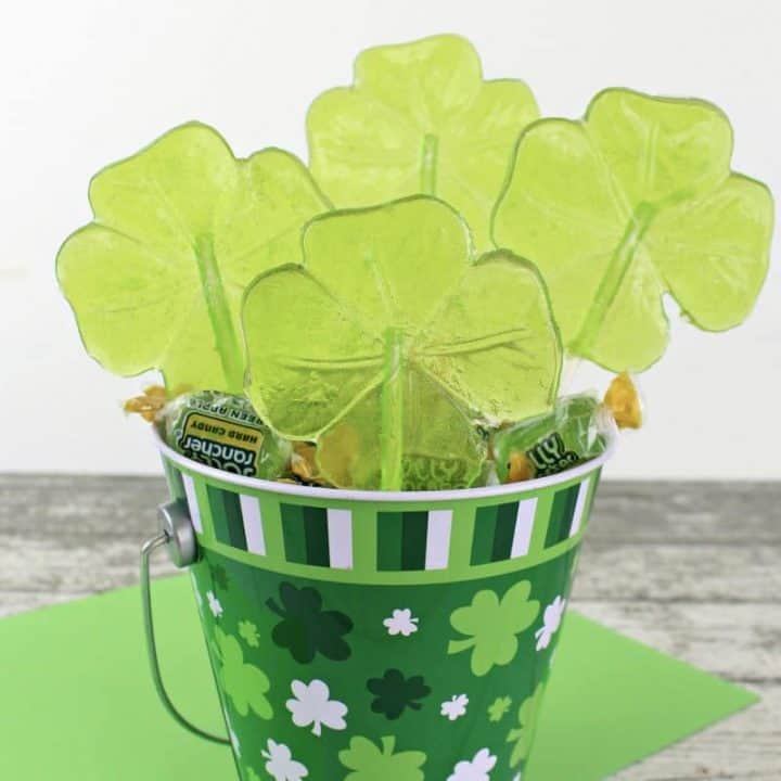 These beautiful green shamrock lollipops will make the perfect treat for your St. Patrick's Day party. You will not believe how easy they are to make!