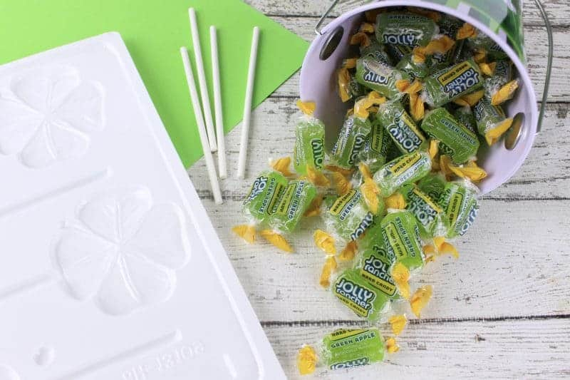 Green shamrock Jolly Rancher lollipops will make the perfect treat for your St. Patrick's Day party. They are as easy to make as crushing the candies, placing them in the mold, and popping them in the oven!