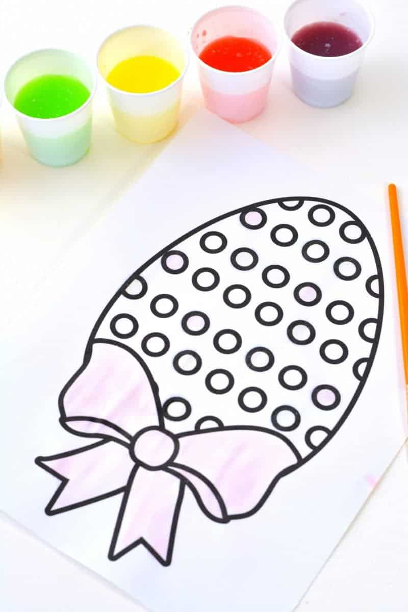 Looking for a fun Easter kids activity?! How about making 2-ingredient watercolor paint with Skittles candies?! See how to make skittles paints and download a free Easter egg coloring page printable.