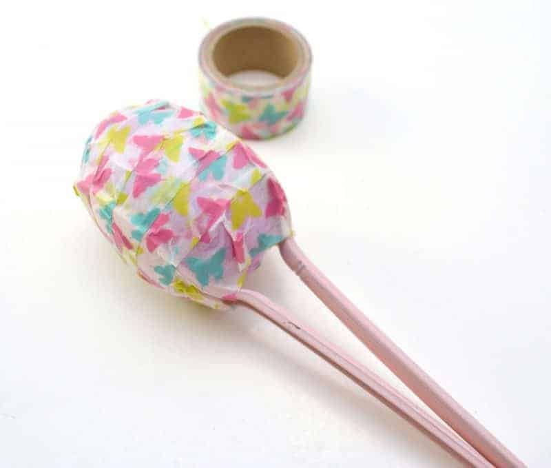 Easter egg maracas are a fun DIY instrument for toddler and preschoolers. They are easy to make using plastic eggs, plastic spoons, washi tape, and rice or beans.