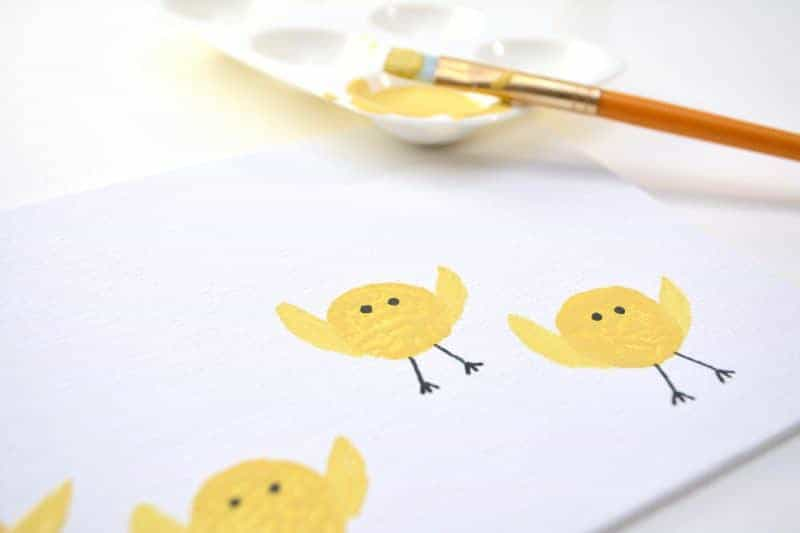 Are you looking for a fun Easter chicks craft idea? This cute baby chicks kids art project is made by stamping wine corks into yellow paint. It's the perfect kids activity for the rainy (or even snowy) days leading up to Easter.