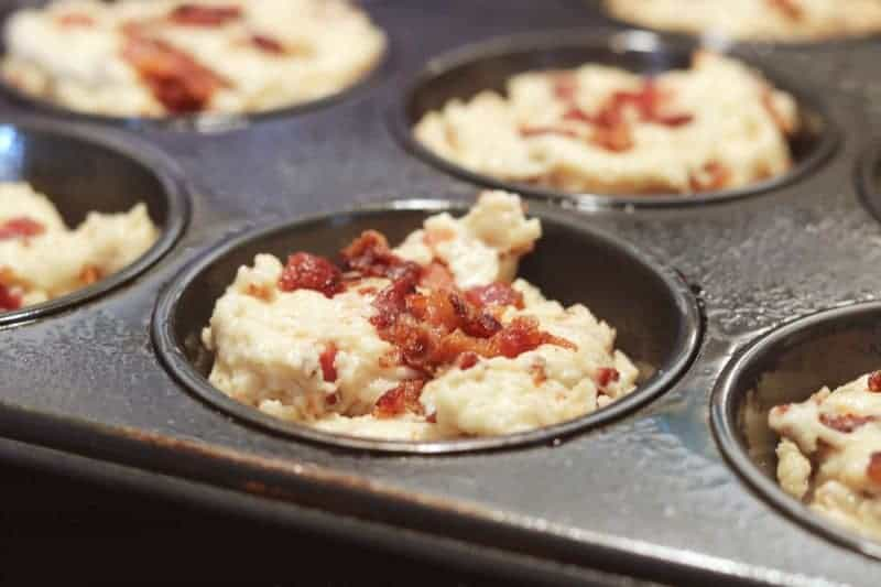 Savory bacon muffins are a hearty and delicious breakfast packed with bits of applewood smoked bacon and a hint of sweet maple flavor.