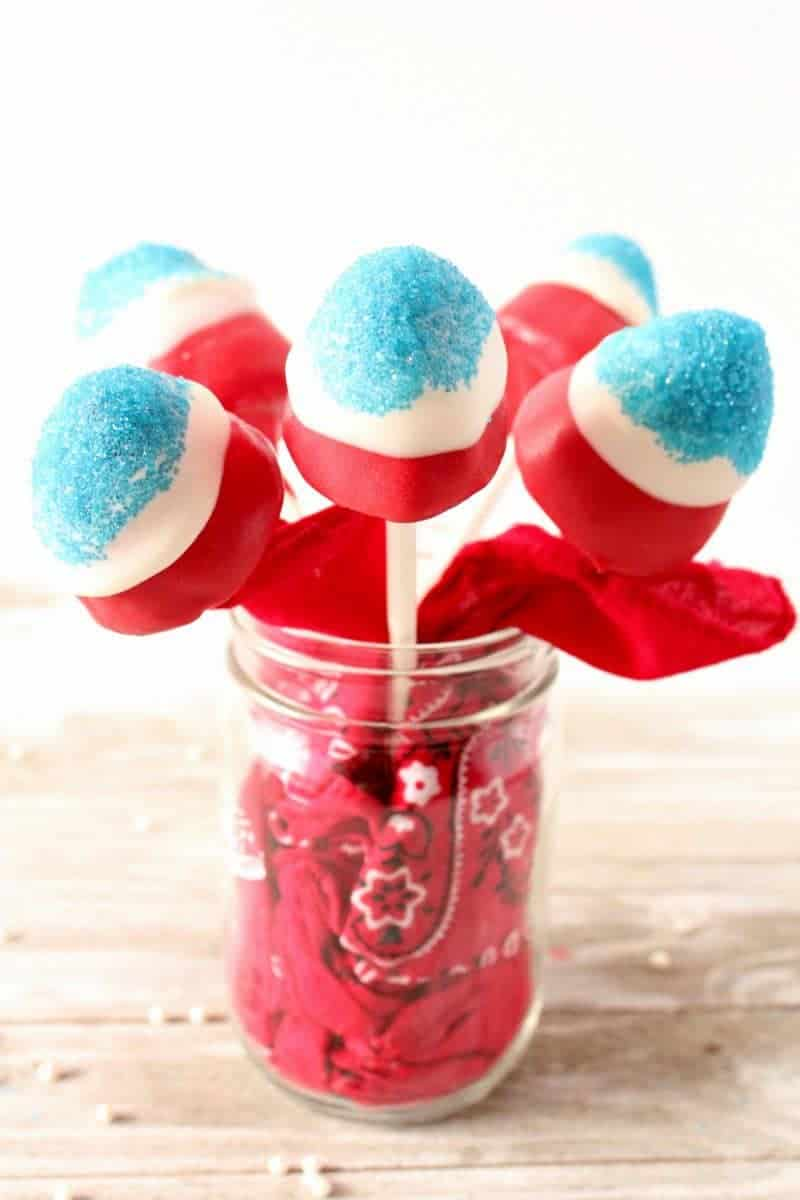 Firecracker Strawberry Pops are a fun and festive dessert perfect for a 4th of July BBQ, patriotic Memorial Day celebration, or laid back Labor Day. These no bake red, white, and blue treats are easy to make, adorable, and tasty as can be.
