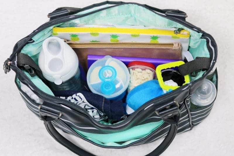 Instead of lugging my diaper bag and my handbag around this summer, I decided to combine the two. And today I am sharing a little peek at what's inside.