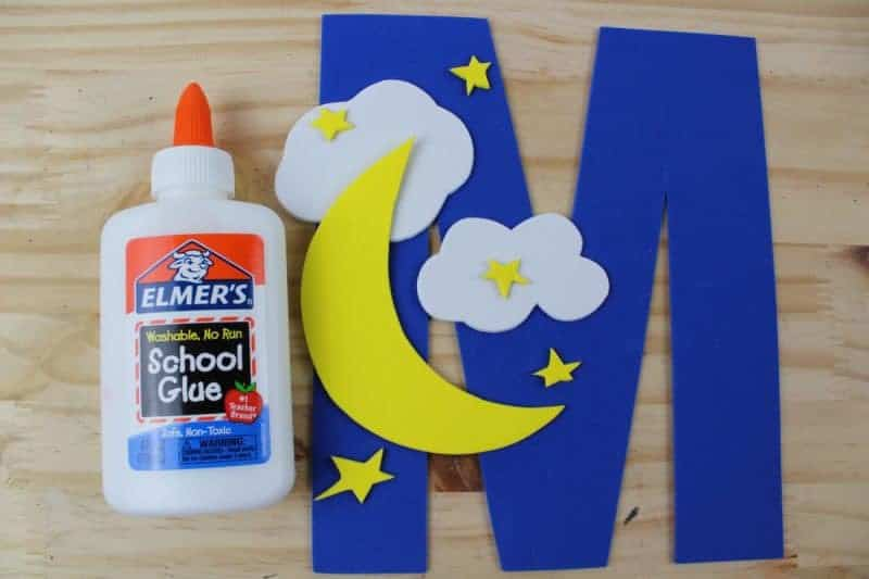 Glue the moon and the clouds on to the letter M