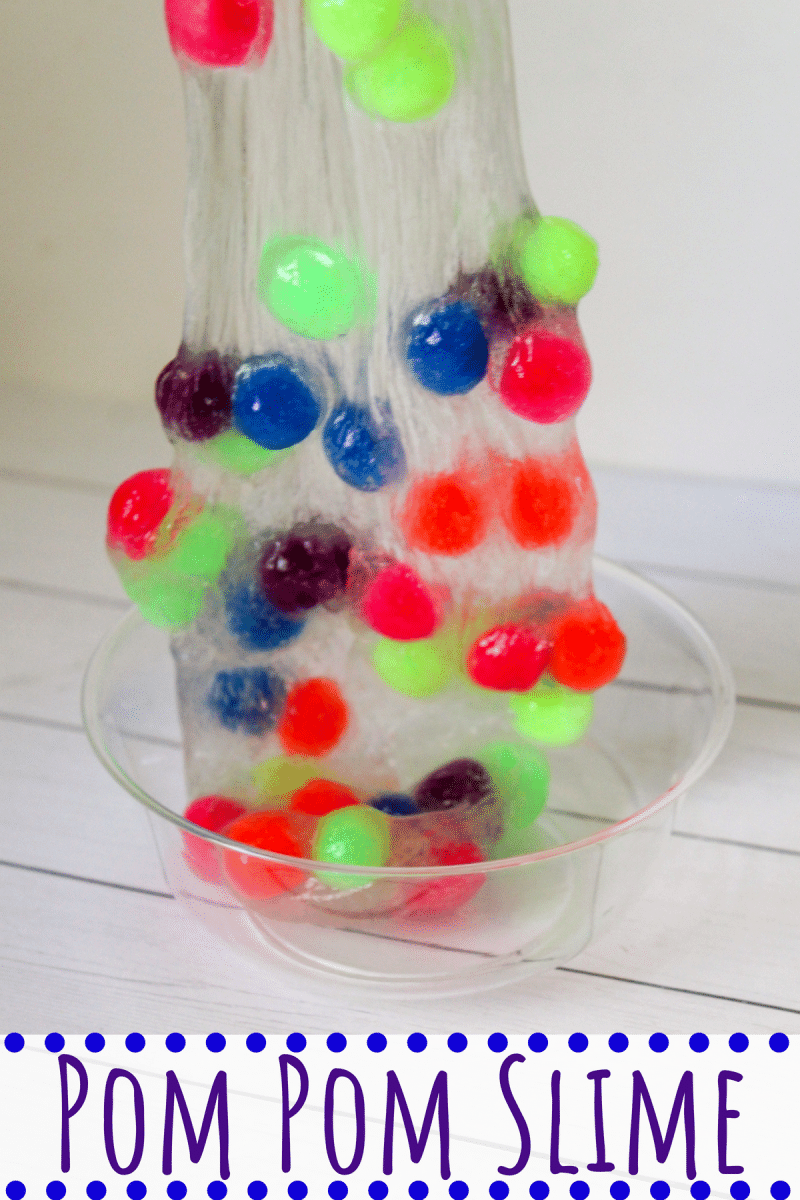 This 4-ingredient pom pom slime features brightly colored pom poms suspended in a clear slime for a bright, colorful, and fun sensory activity for kids.