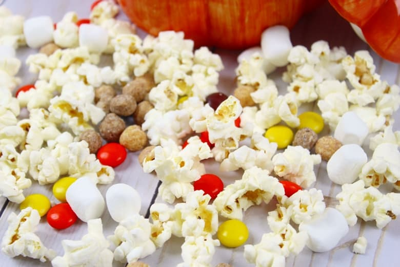 Fall snack mix in a pumpkin bowl