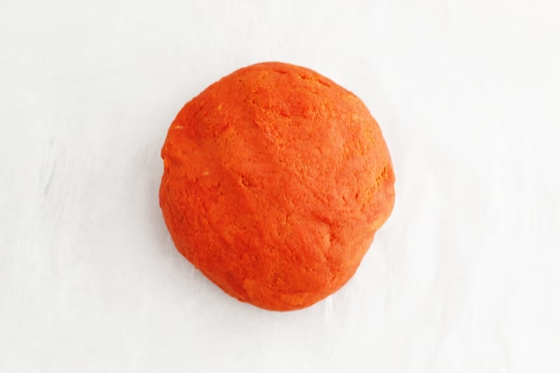 Knead playdough until color is consistent throughout and texture is smooth