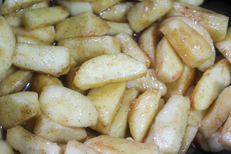 In process image of apples in crockpot