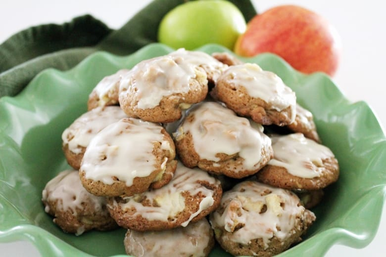 These soft apple cookies combine tender pieces of apple, crunchy bits of toasted pecans, and a sweet glaze for a completely irresistible Fall dessert.