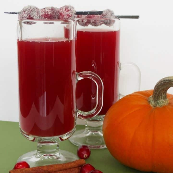 Cranberry apple cider made with sweet tea is an amazing twist on typical hot apple cider, and is easy to make at home in your crockpot or slow cooker.