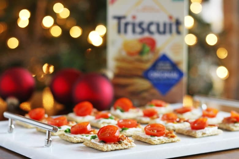 We top Triscuit crackers with cream cheese, bacon, and tomato for a quick and easy holiday appetizer.