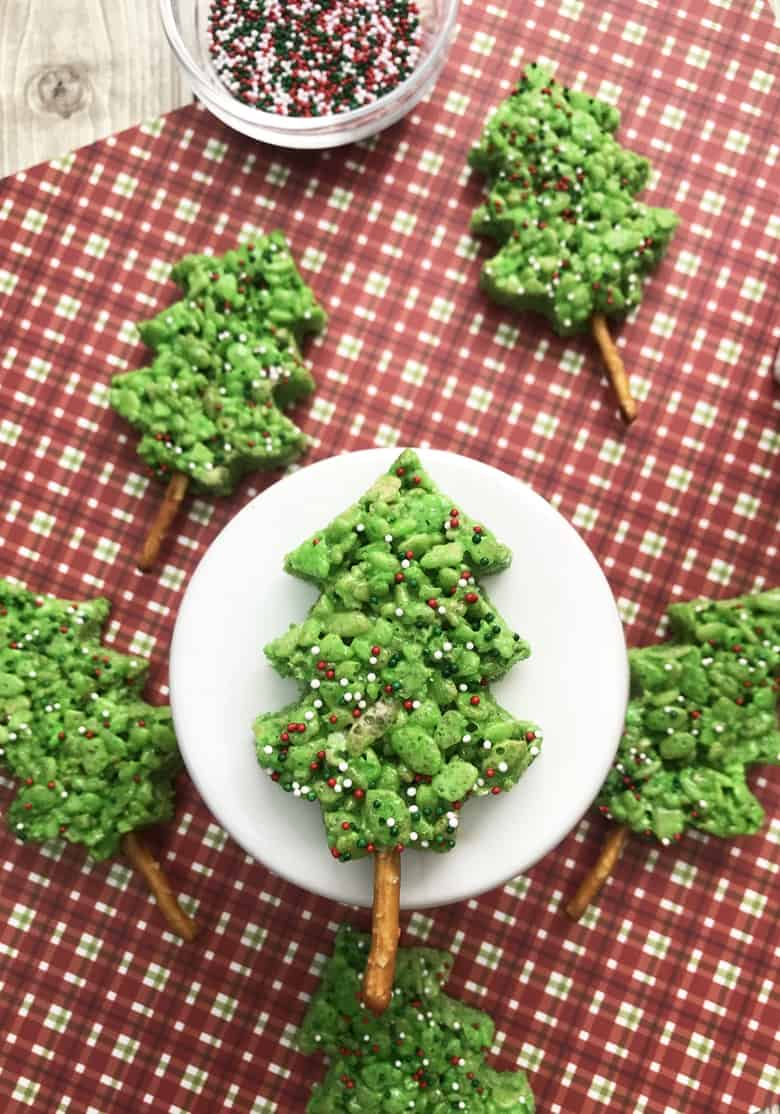These easy-to-make, no bake, green Christmas Tree Rice Krispie Treats are sure to be the hit of the dessert table this Christmas– especially with the kids!