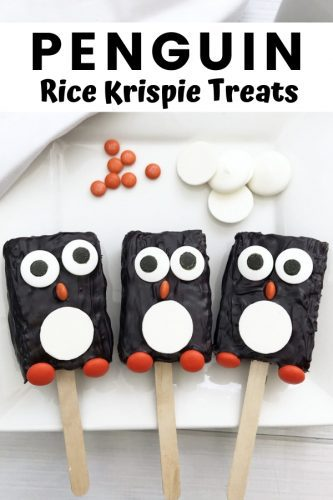 These adorable penguin Rice Krispie Treats take minutes to make using store-bought Rice Krispie Treats, candy melts, and a few candies.
