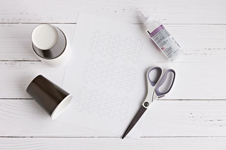 Stitching printable, brown paper cups, scissors, and glue
