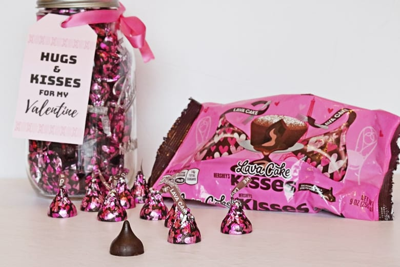 """An easy mason jar Hershey Kisses Valentine gift tutorial, complete with a printable """"hugs and kisses for my Valentine"""" label."""