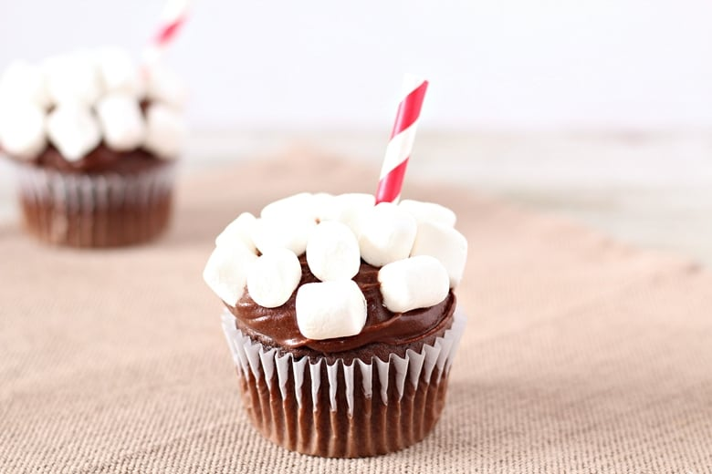 Turn a boxed Devil's Food Cake Mix, store bought icing, and mini marshmallows into fun hot chocolate cupcakes with this easy recipe.
