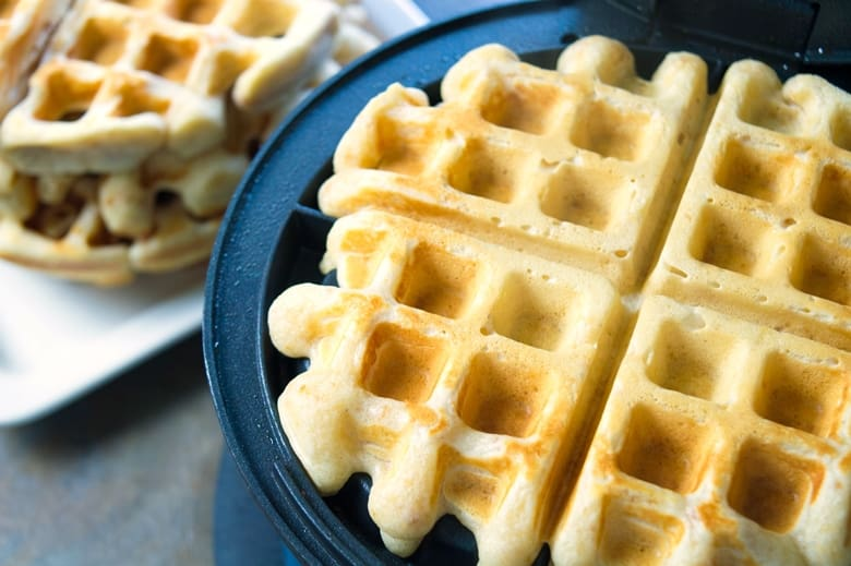 Reese's waffles in waffle iron, cooked to a golden color