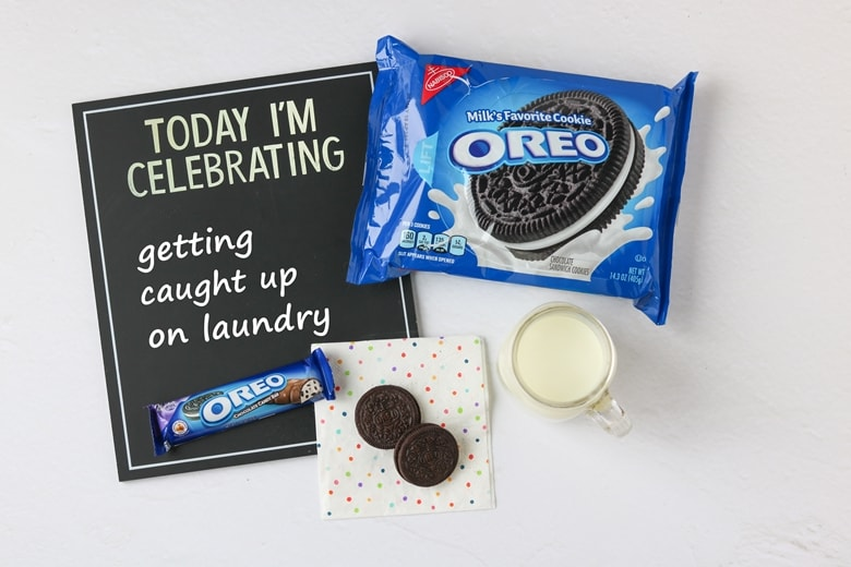 "OREO Cookies, OREO Candy Bar, glass of milk, and chalkboard that reads ""Today I'm celebrating getting caught up on laundry"""