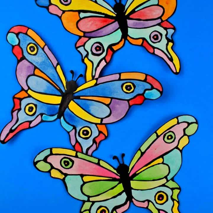 How to make a faux stained-glass butterfly craft using cardstock, glue, watercolors, and the provided printable butterfly template.