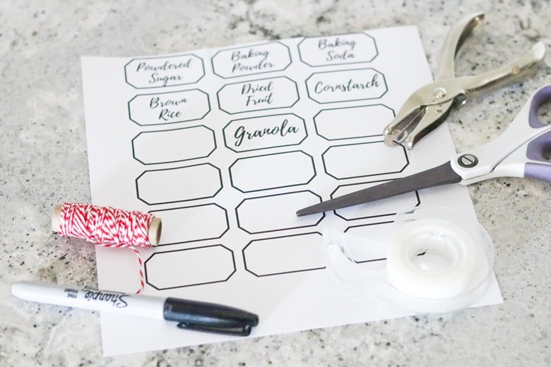 Printable Pantry Organization Labels, scissors, twine, hole punch and marker