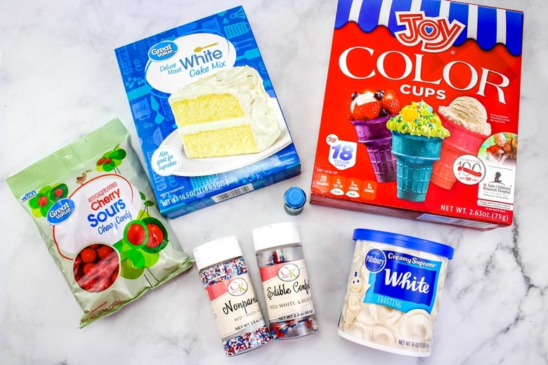 Box of Joy brand ice cream cones, white cake mix white frosting, sour cherry candies, blue food coloring, and patriotic sprinkles