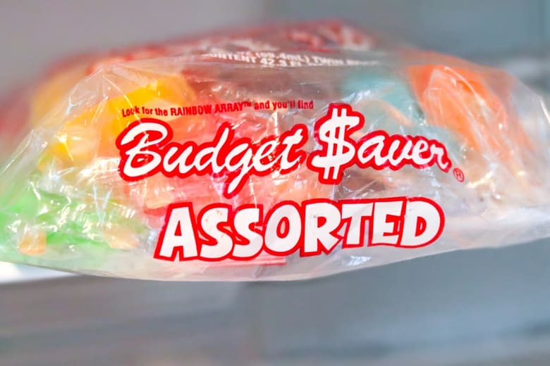 Bag of Budget Saver Assorted Popsicles on shelf in freezer