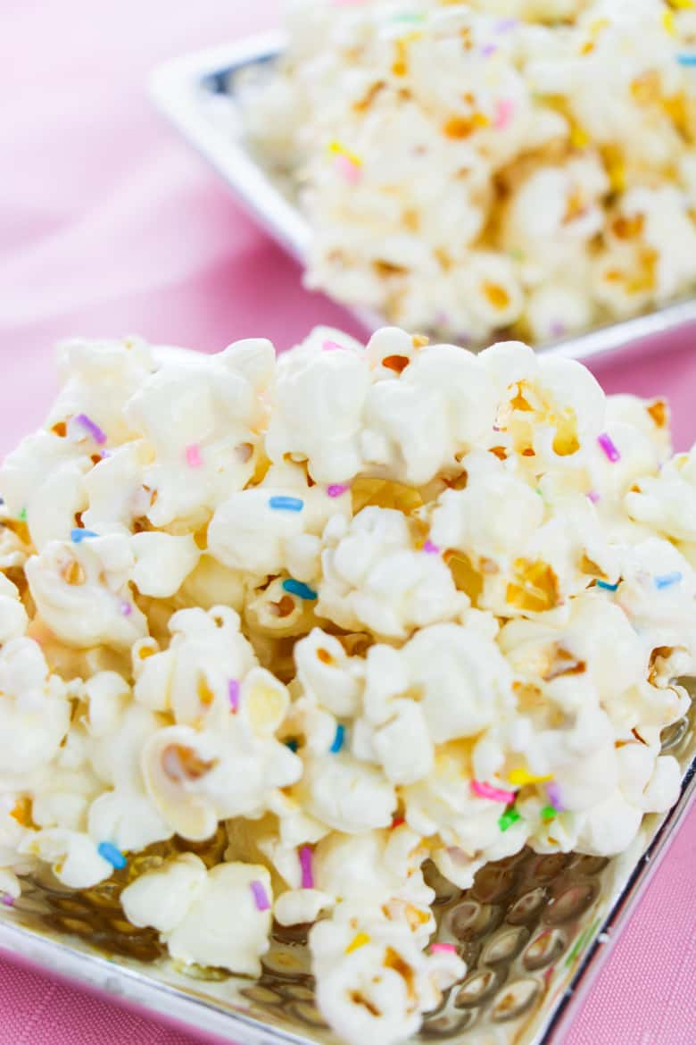 Funfetti popcorn served on two small silver platters